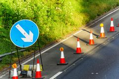 UK Road Services Roadworks Cones and directional Signs on motorway.  stock photography