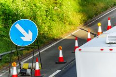 UK Road Services Roadworks Cones and directional Signs on motorway.  royalty free stock photography