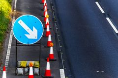 UK Road Services Roadworks Cones and directional Signs on motorway.  stock images