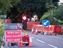 Free Uk Roadworks On Village Road With Red Stoplight Traffic Control Royalty Free Stock Photo - 193585565
