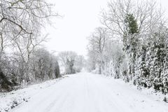 UK rural road with snow in winter stock photography