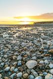 UK seaside sunset. Taken near Seven Sisters, on the coast near Brighton UK Royalty Free Stock Images