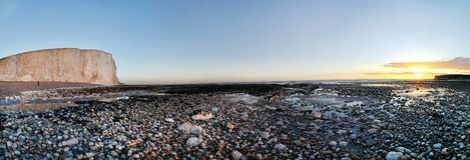 UK-sjösidasolnedgång arkivfoton