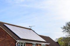 UK Solar Energy Panel on Sunny Roof.  Stock Photo