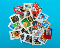 UK stamp assortment, still on envelope, on blue Royalty Free Stock Image
