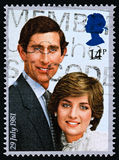 UK stamp of Prince Charles and Lady Diana 1981. A postage stamp printed in United Kingdom shows a picture of Prince Charles and Lady Diana Spencer commemorating royalty free stock image
