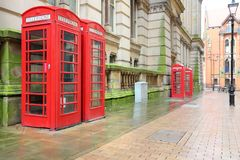 UK symbol. Red telephone booths in Birmingham, England stock photography