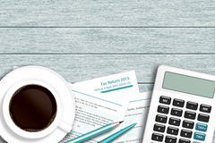 UK tax form with calculator, coffee lying on wooden desk. With place for text Royalty Free Stock Photo