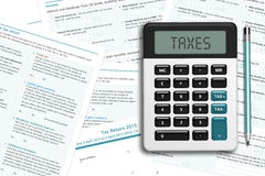 UK tax form with calculator lying on wooden desk Royalty Free Stock Photography