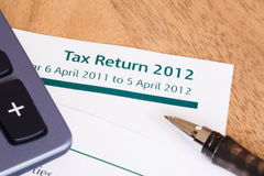 UK Tax Return 2012. Closeup of UK Income tax return form with tax period for 2012 Royalty Free Stock Photos