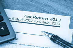 UK tax return 2013. Cool toned image of UK income tax return form for 2013 Royalty Free Stock Image