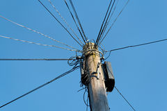 UK Telegraph Pole. An UK telegraph pole with complicated wiring Royalty Free Stock Photos