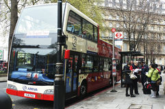 UK tourists. Picture of UK tourists in London in the famous hop on hop off sightseeing tour stock photos