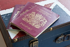 UK Travel. United Kingdom Passports on a suitcase with the UK flag depicting the concept of travel Stock Image