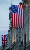 UK and US flag in London at Piccadilly Circus royalty free stock images