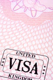 UK visa document immigration stamp passport page close up, copy space, vertical Royalty Free Stock Photo
