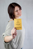 Uk work permission. Bulgarian immigrant holding uk work permission card for bulgarians and romanians Stock Photo