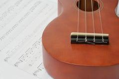 Ukulele and Sheet Music Stock Image