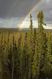 Ukon Territory Rainbow. A double rainbow over a Ukon Territory field Royalty Free Stock Images