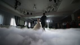 Ukrailne. LVIV. 19 JAN 2019. Dance of brides at the wedding. Heavy smoke that is highlighted with white light. The first