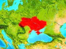 Ukraina i rött på jord Arkivfoto