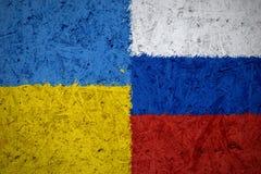 Ukraina och ryssflaggor Arkivbild