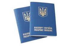 Ukraina paszport z krajowym żakietem ręki, odizolowywa na białym zakończeniu Obrazy Stock
