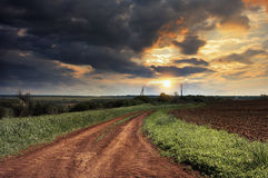 Ukraina.Stepnoy landscape. Country road. Stock Photos