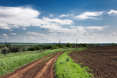 Ukraina.Stepnoy landscape. Country road. Royalty Free Stock Images