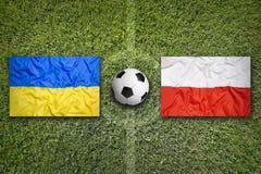 Ukraina vs Polen på fotbollfält Fotografering för Bildbyråer