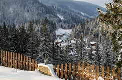 UKRAINE – February  2017: Snow-covered hotel complex in the winter forest. UKRAINE – February  2017: Snow-covered hotel complex in the beautiful winter Stock Image