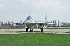 Ukraine Air Force MiG-29. Vasilkov, Ukraine - April 24, 2012: Ukraine Air Force MiG-29 is taxiing to the runway for takeoff into another training flight Royalty Free Stock Images