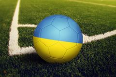 Ukraine ball on corner kick position, soccer field background. National football theme on green grass.  vector illustration