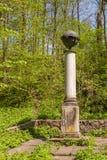UKRAINE, BELAYA TSERKOV : Column with a globe in the eastern rav Royalty Free Stock Photo