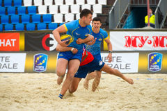 Ukraine blue vs Italy. MOSCOW, RUSSIA - JULY 22-23, 2017: Rugby players in action at the  on European Beach Fives Rugby Championship 2017 in the match Ukraine Royalty Free Stock Photo