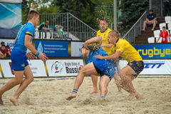 Ukraine blue vs Romania yellow. MOSCOW, RUSSIA - JULY 22-23, 2017: Rugby players in action at the  on European Beach Fives Rugby Championship 2017 in the match Royalty Free Stock Photos