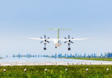 Ukraine, Borispol - MAY 22 :  Bombardier Dash 8 Q400 Air Baltic is landing at the international airport Borispol on May 22, 2015 Royalty Free Stock Photography