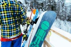 Ukraine, bukovel - December 17, 2017: man rest after snowboarding royalty free stock image