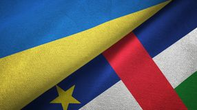 Ukraine and Central African Republic two flags textile fabric texture vector illustration