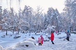 UKRAINE - CHERKASY JANUARY 20, 2018 People playing in winter park. Seasonal joy and recreation. stock photography