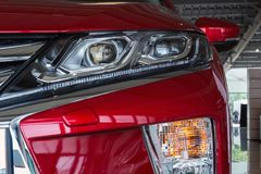 Ukraine, Cherkasy, May 2019. Headlight of a modern  red car. Close-up. Detail of automotive lighting system. Ukraine, Cherkasy, May 2019. Headlight of a modern stock photos