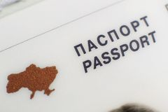 Ukraine country golden shape in passport close up. Ukraine country golden shape in foreign passport close up word emigration royalty free stock photos