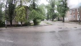 Depressed area during the rain. UKRAINE, DNIPER - Jule 20, 2019: Depressive area during the rain and the road to the market in the Pridneprovsky housing estate stock footage