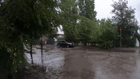 Depressed area during the rain. Ukraine, Dniper - July 20, 2019: Depressive area during the rain and the road to the market in the Pridneprovsky housing estate stock video footage