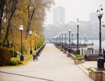 UKRAINE, DONETSK, NOVEMBER, 03, 2015: Autumn quay with beautiful lanterns Royalty Free Stock Images