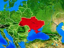 Ukraine on Earth with borders. Ukraine from space on model of planet Earth with country borders and very detailed planet surface. 3D illustration. Elements of royalty free stock photo