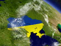 Ukraine with embedded flag on Earth Stock Photo