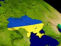 Ukraine with flag on Earth Stock Photo