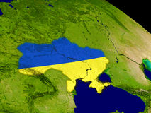 Ukraine with flag on Earth Royalty Free Stock Photography
