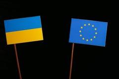 Ukraine flag with European Union EU flag  on black Royalty Free Stock Images